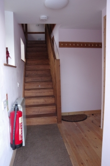 from the same location with stairs reoriented and floor flush with outdoor ground level